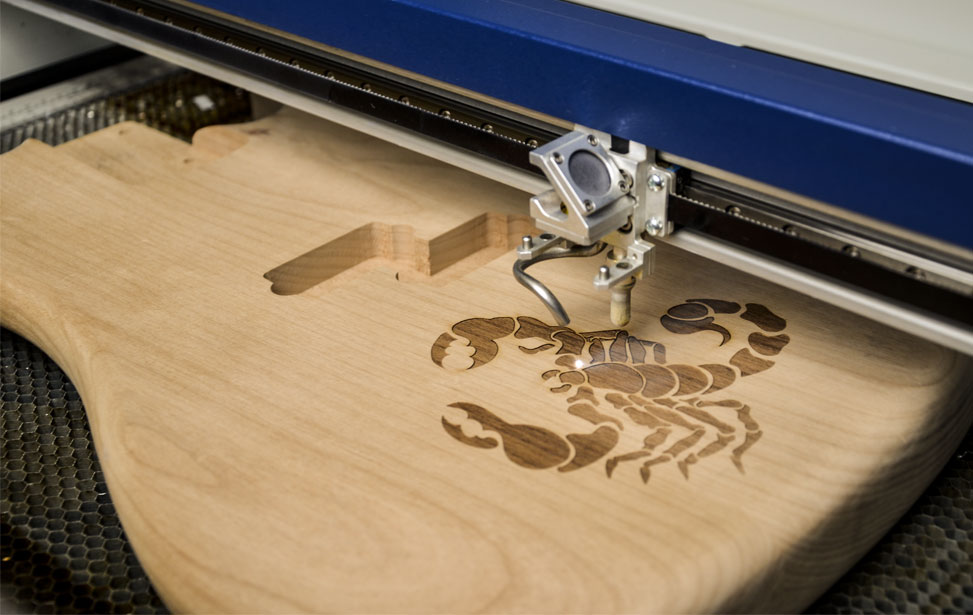 What is Laser engraving and the different materials on which marks used?